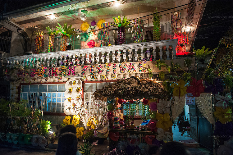 The home decorating contest in Sampaloc's Bulihan Festival was held at night this year.  There were over 160 homes competing using a combination of lighting and decorations made from buri or buri products.  Top prize this year was 15,000 Philippine pesos donated by the Buri Bag Project (which is over two months' salary for most Filipino skilled laborers). (Sampaloc, Quezon Province, the Philippines.)
