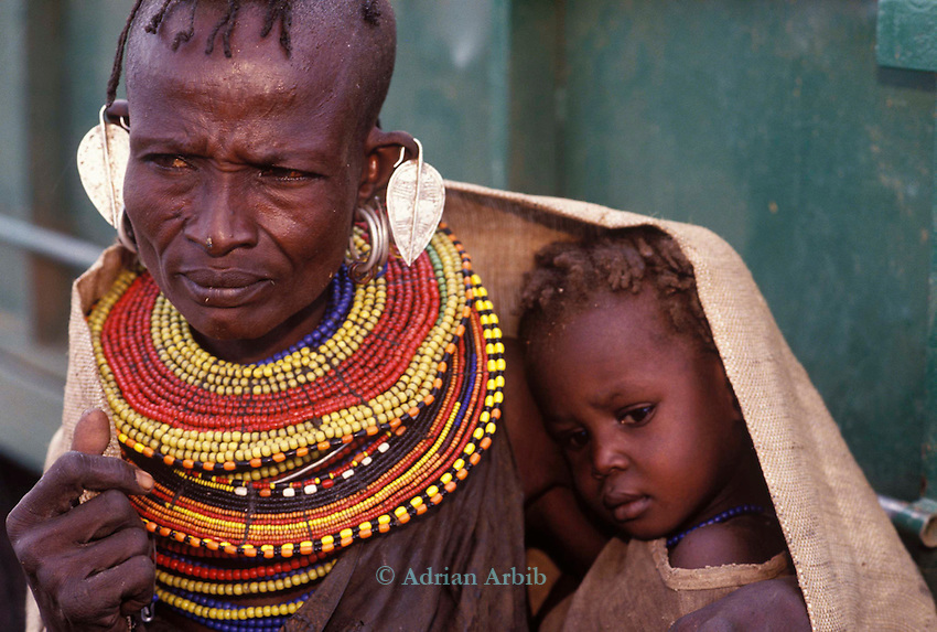 A Turkana mother annd child  wait for famine relief on the edge of the Suguta Valley...Northern Kenya.....
