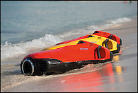 BNPS.co.uk (01202 558833)<br /> Pic: Seabob/BNPS<br /> <br /> ***Please Use Full Byline***<br /> <br /> Das Boot - German engineers have launched a James Bond-style 'underwater jetski' which enables watergoers to &quot;swim like a dolphin&quot;.<br /> <br /> The cutting-edge watercraft uses a revolutionary electric jet which generates 700 newtons of thrust, propelling users along under the waves at speeds of up to nine miles per hour with a range of 60 minute before recharging.<br /> <br /> The jet system is the first in the world to feature an impeller powered by an electric motor, which sucks in water then fires it out the back of the craft.<br /> <br /> It can dive to more than 100ft, and the craft's speed is controlled by hand controls to flick through its 10 gears.<br /> <br /> The craft is steered by using bodyweight to angle the craft, while an onboard computer informs users of power usage, depth, water temperature and speed.<br /> <br /> The range start at &pound;7000 but buyers can splash out almost &pound;30,000 for a top of the range one that comes with all the added extras.<br /> <br /> The futuristic machine, called the Seabob F7 Titanium, is the brainchild of Cayogo based in Stuttgart, Germany.