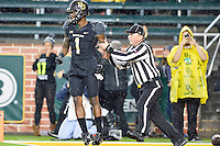Game official restraints Baylor inside receiver Corey Coleman (1) to prevent a fight with Oklahoma State cornerback Ramon Richards (18) during first half of an NCAA football game, Saturday, November 22, 2014 in Waco, Tex. Baylor defeated Oklahoma State 49-28. (Mo Khursheed/TFV Media via AP Images)