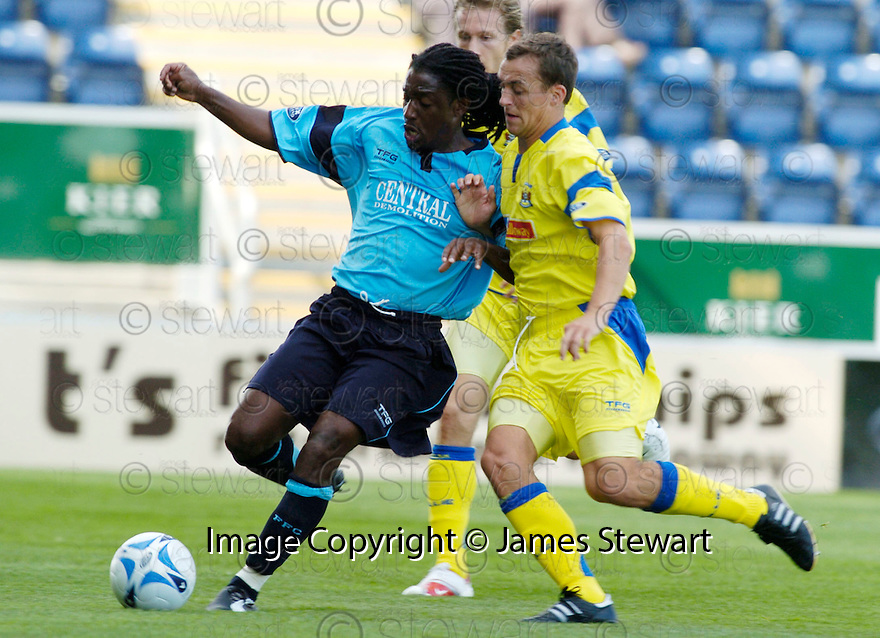 19/08/2006        Copyright Pic: James Stewart.File Name : sct_jspa16_falkirk_v_kilmarnock.RUSELL LATAPY AND GARY HAY CHALLENGE FOR THE BALL.........Payments to :.James Stewart Photo Agency 19 Carronlea Drive, Falkirk. FK2 8DN      Vat Reg No. 607 6932 25.Office     : +44 (0)1324 570906     .Mobile   : +44 (0)7721 416997.Fax         : +44 (0)1324 570906.E-mail  :  jim@jspa.co.uk.If you require further information then contact Jim Stewart on any of the numbers above.........