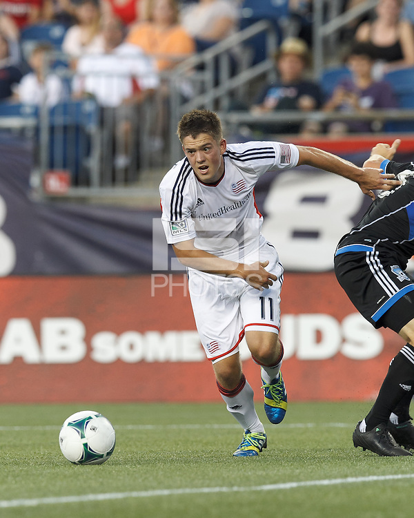 New England Revolution midfielder Kelyn Rowe (11) tracks loose ball. In a Major League Soccer (MLS) match, the New England Revolution (white) defeated San Jose Earthquakes (black), 2-0, at Gillette Stadium on July 6, 2013.