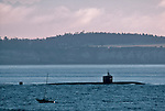 Nuclear submarine, Puget Sound, US Navy ship passes a sailboat en route Bangor Navy Base, Point Wilson, Port Townsend, Admiralty Inlet, Washington State, USA
