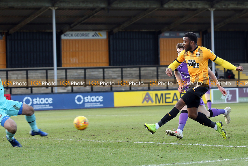 Scott Brown of Port Vale saves from David Amoo of Cambridge United after beating Adam Crookes of Port Vale during Cambridge United vs Port Vale, Sky Bet EFL League 2 Football at the Cambs Glass Stadium on 9th February 2019