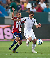 CARSON, CA – July 2, 2011: Chivas USA defender Paolo Nagamura (5) and Chicago Fire forward Diego Chaves (99) during the match between Chivas USA and Chicago Fire at the Home Depot Center in Carson, California. Final score Chivas USA 1, Chicago Fire 1.