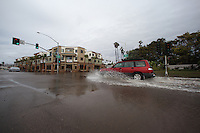 Thursday, Jan 21, 2010:  A car drives through the intersection of Mission Blvd and Pacific Drive shortly after it was re-opened to traffic on Thursday afternoon.  Flood waters had reached several feet at one point on Wednesday evening according to San Diego City crews working at the scene.  WInter storms battered Southern California for a fourth day in a row, bringing strong wind, high surf and rain that caused flooding in many parts of San Diego.