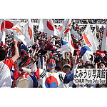 April, 29th : Tokyo, Japan - Korea and Japan Fans waving  Japanese and Korean flags at the Tokyo's National Stadium during the 2002 KIRIN Challenge Cup : Japan VS Slovakia. (Photo by Kentaro Aoyama)