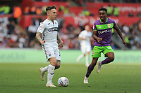 Barrie McKay of Swansea City vies for possession with Niclas Eliasson of Bristol City during the Sky Bet Championship match between Swansea City and Bristol City at the Liberty Stadium, Swansea, Wales, UK. Saturday 25 August 2018
