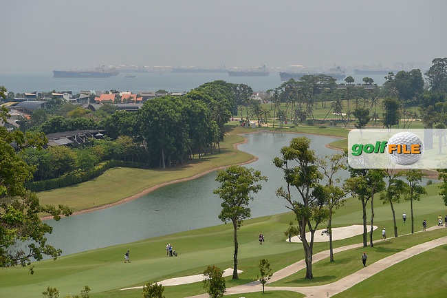 A long view of the fareway on 5 with the oil tankers in the queue in the harbor during Rd 2 of the Asia-Pacific Amateur Championship, Sentosa Golf Club, Singapore. 10/5/2018.<br /> Picture: Golffile | Ken Murray<br /> <br /> <br /> All photo usage must carry mandatory copyright credit (© Golffile | Ken Murray)