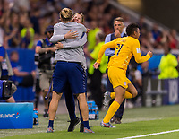 LYON,  - JULY 2: Jill Ellis and Tony Gustavsson celebrate during a game between England and USWNT at Stade de Lyon on July 2, 2019 in Lyon, France.