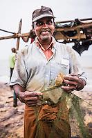 Portrait of a fisherman in Negombo fish market (Lellama fish market), Negombo, West Coast of Sri Lanka, Asia. This is a portrait of a fisherman in Negombo fish market (Lellama fish market), Negombo, West Coast of Sri Lanka, Asia.