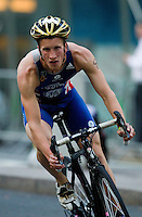 30 JUN 2011 - LONDON, GBR - Richie Nicholls - Men's Super Sprint elimination round - GE Canary Wharf Triathlon .(PHOTO (C) NIGEL FARROW)