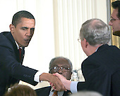 Washington, DC - March 4, 2009 -- United States President Barack Obama shakes hands with Senate Minority Leader Mitch McConnell (Republican of Kentucky) and House Republican Whip Eric Cantor (Republican of Virginia) at a dinner for Congressional  Committee chairmen and ranking members in the East Room of the White House on March 4, 2009. House Democratic Whip James Clyburn (Democrat of South Carolina) looks on from lower center..Credit: Dennis Brack - Pool via CNP