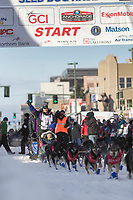 Jessie Royer and team leave the ceremonial start line with an Iditarider at 4th Avenue and D street in downtown Anchorage, Alaska on Saturday March 2nd during the 2019 Iditarod race. Photo by Brendan Smith/SchultzPhoto.com