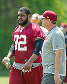 Washington Redskins defensive end Chris Baker (92) and head coach Jay Gruden, right, participate in an organized team activity (OTA) at Redskins Park in Ashburn, Virginia on Wednesday, May 25, 2015.<br /> Credit: Ron Sachs / CNP