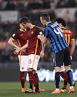 Calcio, Serie A: Roma vs Inter. Roma, stadio Olimpico, 19 marzo 2016.<br /> Roma&rsquo;s Miralem Pjanic, left, is helped by FC Inter&rsquo;s Ivan Perisic after getting injured during the Italian Serie A football match between Roma and FC Inter at Rome's Olympic stadium, 19 March 2016. The game ended 1-1.<br /> UPDATE IMAGES PRESS/Isabella Bonotto