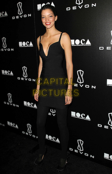 SHAYE LONDRE .Grand Opening Of Devon Flagship Store in Beverly Hills held At Devon Store, Beverly Hills, CA, USA, .8th December 2010..full  length black dress  cleavage tights low cut .CAP/ADM/KB.©Kevan Brooks/AdMedia/Capital Pictures.