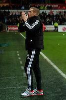 Saturday 2nd Febuaray 2014<br /> Pictured: Garry Monk, Manager of Swansea City applauds fans<br /> Re: Barclays Premier League Swansea City FC  v Cardiff City FC at the Liberty Stadium, Swansea