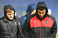 Exeter City players brave the elements prior to kick off during Portsmouth vs Exeter City, Leasing.com Trophy Football at Fratton Park on 18th February 2020