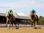 Uno Mas Modelo (no. 8), ridden by Eric Cancel and trained by Antrhony Quartarolo, wins Race 7 July 29 at Saratoga Racecource, Saratoga Springs, NY.  (Bruce Dudek/Eclipse Sportswire)