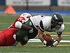 Nick Silva #23 of Floyd picks up yards after a catch as Gerard Smikle #54 of Freeport tackles him during the Class I Long Island Championship at Shuart Stadium in Hempstead on Saturday, Nov. 24, 2018.
