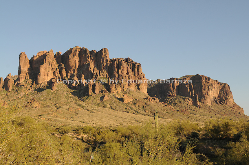 Apache Junction, Arizona. The Lost Dutchman State Park is located in the area of the Superstition Mountains in the Sonoran Desert, 40 miles east of Phoenix, Arizona. The park takes its name from a fabled lost gold mine. This photograph shows a view of the Superstition Mountain from the Treasure Loop Trail. Superstition is a massive monolith that rises 3,000 feet over the adjacent desert floor, and 6,000 feet above the sea level. Photo by Eduardo Barraza © 2011