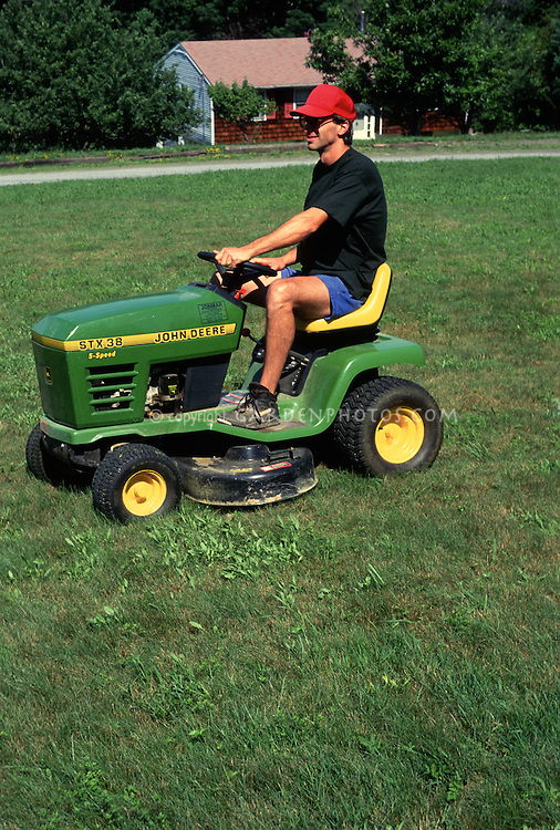 Man On Tractor Lawn Enforcment : Man on riding mower john deere tractor plant