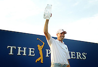 Kelly.Jordan@jacksonville.com--051312--Matt Kuchar holds up The Players Championship trophy after his win during the final round at The Players Championship at TPC Sawgrass Sunday May 13, 2012 in Ponte Vedra Beach, Florida.(The Florida Times-Union, Kelly Jordan)