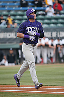 Austen Wade (8) of the TCU Horned Toads jogs to first base after drawing a walk during a game against the Long Beach State Dirtbags  at Blair Field on March 14, 2017 in Long Beach, California. Long Beach defeated TCU, 7-0. (Larry Goren/Four Seam Images)