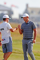Brooks Koepka (USA) does a fist bump with his caddie after making a par saving putt on the 14th hole during the 118th U.S. Open Championship at Shinnecock Hills Golf Club in Southampton, NY, USA. 17th June 2018.<br /> Picture: Golffile | Brian Spurlock<br /> <br /> <br /> All photo usage must carry mandatory copyright credit (&copy; Golffile | Brian Spurlock)