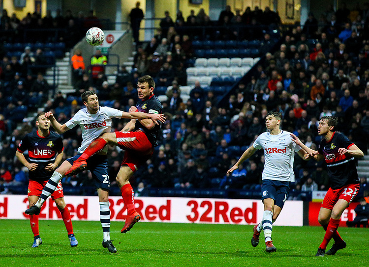 Preston North End's Paul Huntington battles for a header with Doncaster Rovers' Andy Butler<br /> <br /> Photographer Alex Dodd/CameraSport<br /> <br /> The Emirates FA Cup Third Round - Preston North End v Doncaster Rovers - Sunday 6th January 2019 - Deepdale Stadium - Preston<br />  <br /> World Copyright © 2019 CameraSport. All rights reserved. 43 Linden Ave. Countesthorpe. Leicester. England. LE8 5PG - Tel: +44 (0) 116 277 4147 - admin@camerasport.com - www.camerasport.com