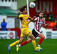 Lincoln City's Alex Woodyard vies for possession with Morecambe's Andrew Fleming<br /> <br /> Photographer Andrew Vaughan/CameraSport<br /> <br /> The EFL Sky Bet League Two - Lincoln City v Morecambe - Saturday August 12th 2017 - Sincil Bank - Lincoln<br /> <br /> World Copyright &copy; 2017 CameraSport. All rights reserved. 43 Linden Ave. Countesthorpe. Leicester. England. LE8 5PG - Tel: +44 (0) 116 277 4147 - admin@camerasport.com - www.camerasport.com