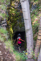 Tourists caving in Lava caves, Mount Etna Volcano, Sicily, UNESCO World Heritage Site, Italy, Europe. This is a photo of tourists exploring Lava caves, Mount Etna Volcano, Sicily, UNESCO World Heritage Site, Italy, Europe.