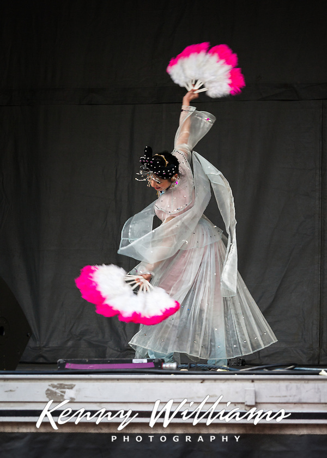 Beautiful Chinese Woman Performing Fan Dance at the Lunar New Year Celebration, Chinatown, Seattle, WA, USA.