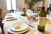Mas Nicot. Mas de Perry. Terrasses de Larzac. Languedoc. Lunch table set for an opulent meal. Fish and shellfish shell fish mousse pate. France. Europe. Bottle. In the dining room.