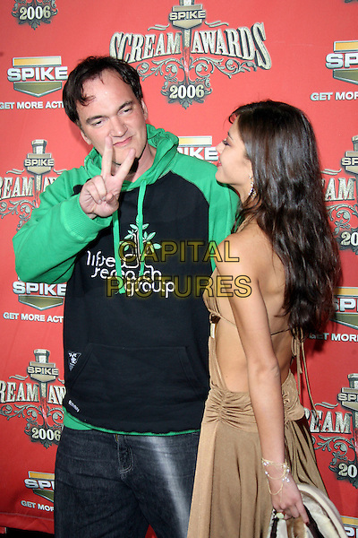 "QUENTIN TARANTINO & GUEST.At Spike TV's ""Scream Awards 2006"", Press Room,. at the Pantages Theatre, Hollywood, California, USA, .7th October 2006..half length green and black hoodie hooded top peace sign funny gesture.Ref: ADM/ZL.www.capitalpictures.com.sales@capitalpictures.com.©Zach Lipp/AdMedia/Capital Pictures."