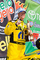 Jun. 1, 2014; Englishtown, NJ, USA; NHRA pro stock driver Jeg Coughlin Jr celebrates after winning the Summernationals at Raceway Park. Mandatory Credit: Mark J. Rebilas-