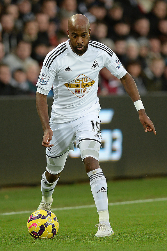 Swansea City's Dwight Tiendalli in action during todays match  <br /> <br /> Photographer /Ashley CrowdenCameraSport<br /> <br /> Football - Barclays Premiership - Swansea City v Chelsea - Saturday 17th January 2015 - Liberty Stadium - Swansea<br /> <br /> &copy; CameraSport - 43 Linden Ave. Countesthorpe. Leicester. England. LE8 5PG - Tel: +44 (0) 116 277 4147 - admin@camerasport.com - www.camerasport.com