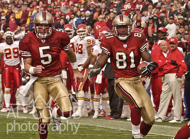 San Francisco 49ers quarterback Jeff Garcia (5) blocks for wide receiver Terrell Owens (81) to make big run on Sunday, November 10, 2002, in San Francisco, California. The 49ers defeated the Chiefs 17-13.