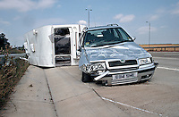 Remains of a car and caravan involved in a road traffic accident on the motorway. The car was travelling too fast and the caravan started to snake. It jack-knifed and dragged the car sideways down the road until it came to rest after the car crashed into the safety barrier..©shoutpictures.com..john@shoutpictures.com