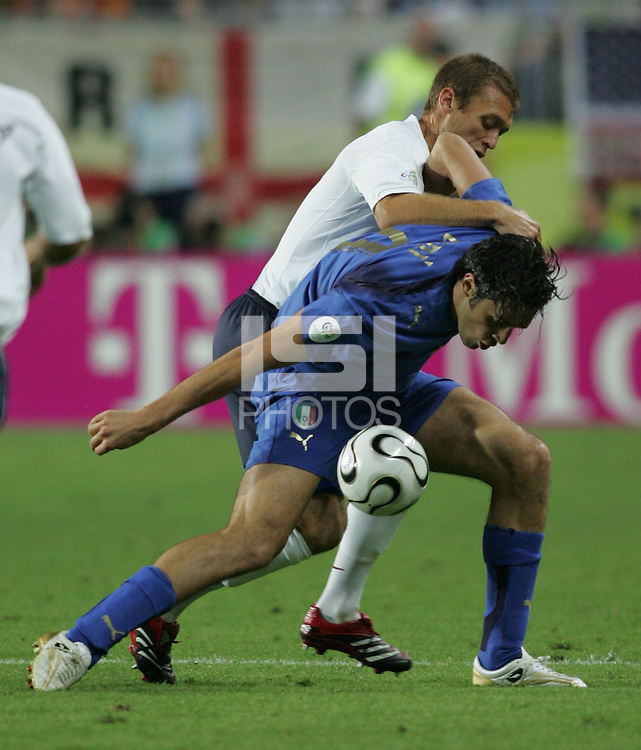 Italian forward (9) Toni Luca is closely guarded by US defender (13) Jimmy Conrad.  USA tied Italy, 1-1, in their FIFA World Cup Group E match at Fritz-Walter-Stadion, Kaiserslautern, Germany, June 17, 2006.