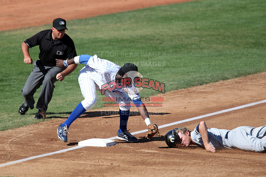 Mesa Solar Sox shortstop Junior Lake #6 tags out Corban Joseph #18 as umpire Chris Segal looks on during an Arizona Fall League game against the Phoenix Desert Dogs at HoHoKam Park on November 3, 2011 in Mesa, Arizona.  Mesa defeated Phoenix 8-7.  (Mike Janes/Four Seam Images)