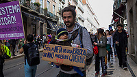 LISBON, PORTUGAL - March 8: A man its seen carriying his baby and holding a banner during a demonstration in International Women´s Day on March 8, 2020 in Lisbon, Portugal.<br /> Actions for international women's day are extended to the wide and the continent.<br /> Rede 8 de Março, a platform that brings together multiple feminist collectives from Portugal. They called for a national feminist strike for International Women's Day in the cities of Amarante, Aveiro, Braga, Coimbra, Évora, Faro, Lisbon, Porto, Viseu, and Vila Real and Ponta Delgada. Despite being celebrated since 1909, International Women's Day was only officially proclaimed by the United Nations in 1975.<br /> Photo by Luis Boza/VIEWpress vía Getty Images