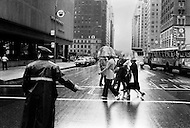 June 1971, New York City, USA. Transparent umbrellas are becoming the hottest fashion accessory in New York. Their practical transparent surround and mushroom shape without the classic protruding spikes makes them less dangerous than their predecessors. They are also a great boon for glasses wearers and women's hairstyles, especially on windy days.