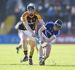 Pierse Lillis of Ballyea in action against Shane O Leary of  Cratloe during the county senior hurling final at Cusack Park. Photograph by John Kelly.