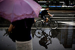 Beijingers try to stay out of the rain in downtown in Beijing, China on Sunday, August 10, 2008.  Kevin German