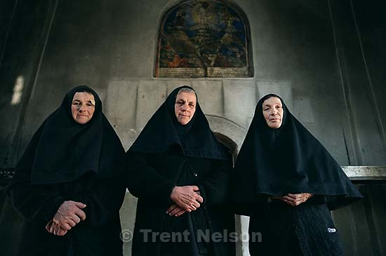 Three Serbian nuns and their 14th Century Orthodox Church, now guarded by KFOR soldiers.<br />