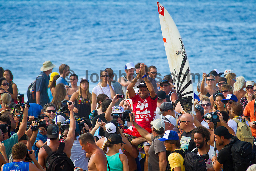 PIPELINE, Oahu/Hawaii (Thursday, December 16, 2010) - Jeremy Flores (FRA) 22, won the Billabong Pipe Masters in memory of Andy Irons over Kieren Perrow (AUS), 33, in a come-from-behind victory in firing four-to-six foot (1.5 metre) backdoor barrels, marking his first career ASP World Tour victory...Joel Parkinson (AUS), 29, was another to stand atop the Billabong Pipe Masters podium, clinching his third, consecutive Vans Triple Crown title to conclude the 2010 ASP World Tour season...Flores, who was in need of a solid 8.60 single-wave score in the dying moments, clawed his way back into the Final against Perrow and threaded the needle on a beautiful righthand barrel to earn a 9.37. Making history as the first European to ever win the Billabong Pipe Masters in the event's 40 year history, Flores punctuated his season with his career-best result..Photo: joliphotos.com