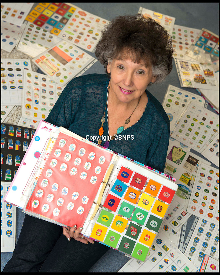 BNPS.co.uk (01202 558833)<br /> Pic: TomWren/BNPS<br /> <br /> Margaret with her collection.<br /> <br /> Pensioner Margaret Archer has a really ap-peeling hobby - as she has become one of the world's leading banana sticker collectors.<br /> <br /> The 73-year-old has amassed over 6,500 small adhesive labels that she has peeled from the yellow fruit.<br /> <br /> Margaret, from Bournemouth, Dorset, keeps her remarkable collection of stickers in A4 folders, listing them alphabetically and by country.