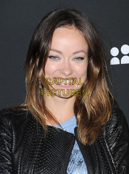 Olivia Wilde<br /> The Myspace Event held at The El Rey Theatre in Los Angeles, California, USA.<br /> June 12th, 2013   <br /> headshot portrait smiling black leather jacket blue top  <br /> CAP/DVS<br /> &copy;DVS/Capital Pictures